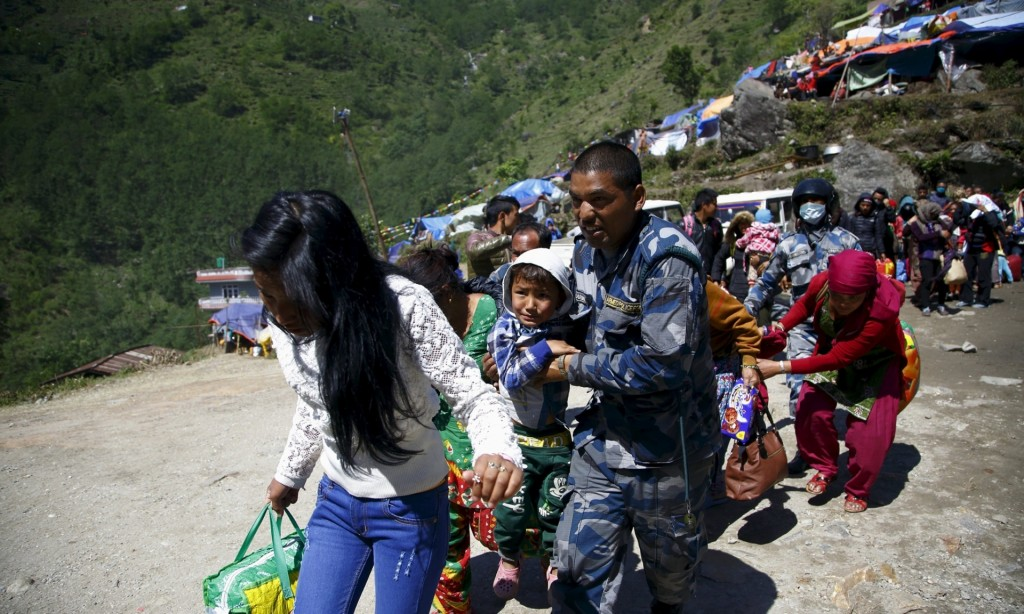 Nepalese evacuating earthquake zone
