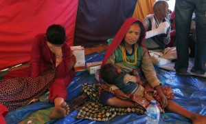 People injured in last month's earthquake rest inside a tent at a makeshift hospital in Chautara, Sindhupalchok district