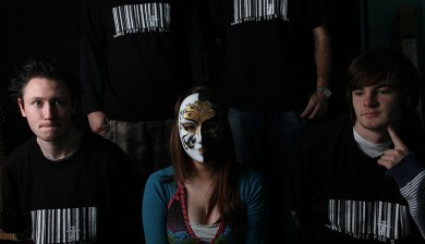 Girl wearing a mask representing 1 of 27 million faceless victims and 4 boys wearing 'No People For Sale' t-shirts.